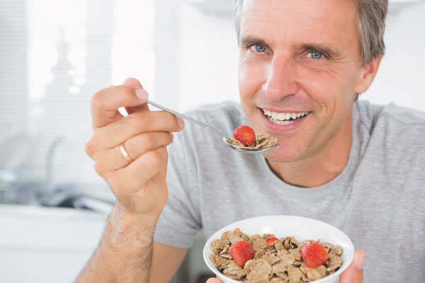 whole grains man eating cereal