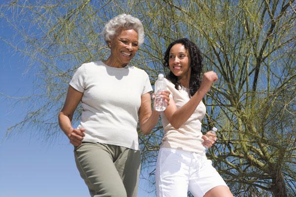 friends walking reducing stress exercising