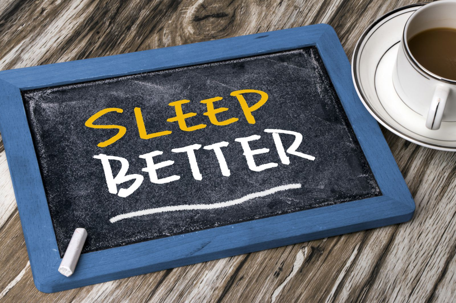 Sleep Better written on a small chalkboard